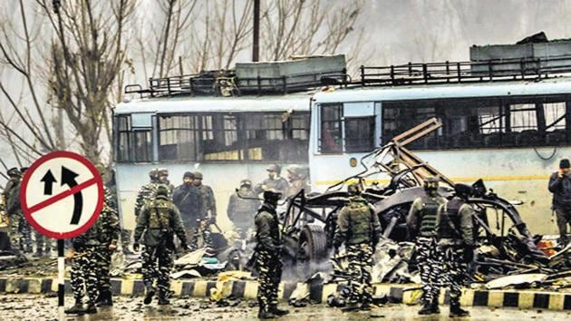 Security personnel carry out the rescue and relief works at the site of suicide bomb attack at Lathepora Awantipora in Pulwama district of south Kashmir.(PTI)