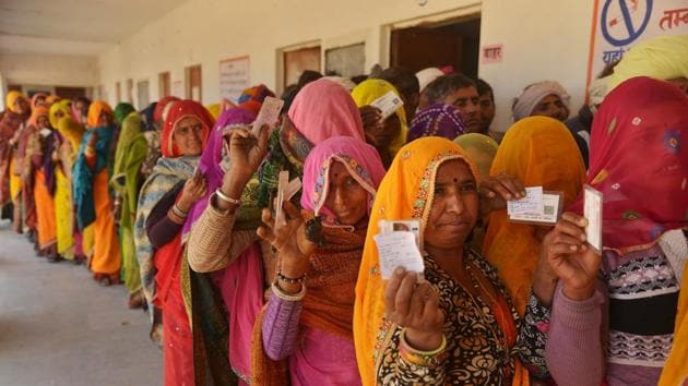 Women stand in a queue to cast vote during the panchayat elections at a polling station in Ajmer, Rajasthan on January 17.(PTI)