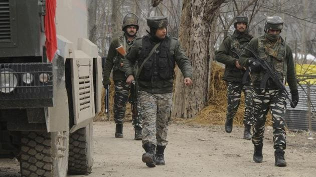 Army personnel patrol near Awantipora.(Photo by Waseem Andrabi / Hindustan Times)