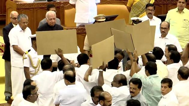 United Democratic Front (UDF) MLAs block Kerala Governor Arif Mohammad Khan as he arrives for the budget session of the state assembly. CM Pinarayi Vijayan looks on.(Photo: ANI)