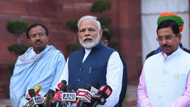 Prime Minister Narendra Modi speaking before entering Parliament as Budget Session begins on Friday.(Mohd Zakir/HT Photo)
