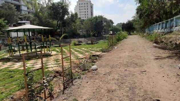 Before the clean up the, which took six months, the site was considered the filthiest in the area. Now, the stretch resembles a mini forest-cum-bio diversity park. Five earth movers were deployed and at least 50 conservation workers worked round the clock to ensure the beautification of the stretch.(HT/PHOTO)
