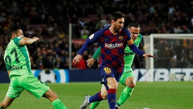 Copa del Rey - Round of 16 - FC Barcelona v Leganes - Camp Nou, Barcelona, Spain - January 30, 2020 Barcelona's Lionel Messi in action with Leganes' Oscar(REUTERS)