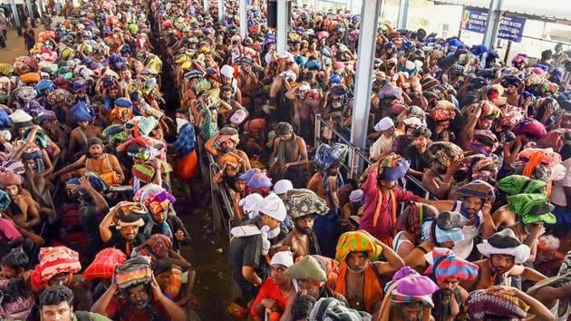 Devotees queue up to offer prayers at Lord Ayyappa temple in Sabarimala.(PTI Photo)
