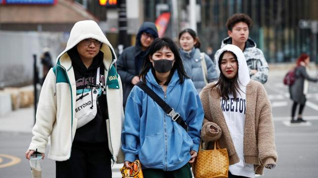 A woman wears a mask in Chinatown following the outbreak of the novel coronavirus, in Chicago, Illinois, US on January 30, 2020.(Reuters Photo)