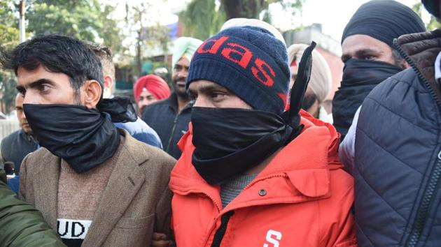 Three of the accused in the custody of special task force of Punjab Police in Amritsar on Friday, Jan 31, 2020.(Sameer Sehgal/HT)