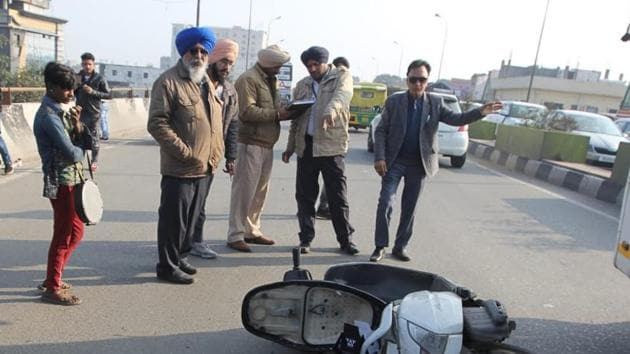Police at the spot where the bus (inset) hit the scooter near the bus stand on Saturday.(GURPREET SINGH/HT)