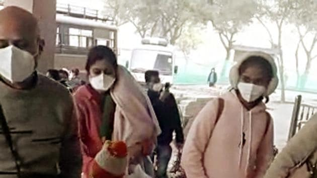 Indian passengers who were brought back by special Air India flight from coronavirus-hit Wuhan wear medical mask at the Indo-Tibetan Border Police (ITBP) medical observation camp, in New Delhi on Saturday.(ANI Photo)