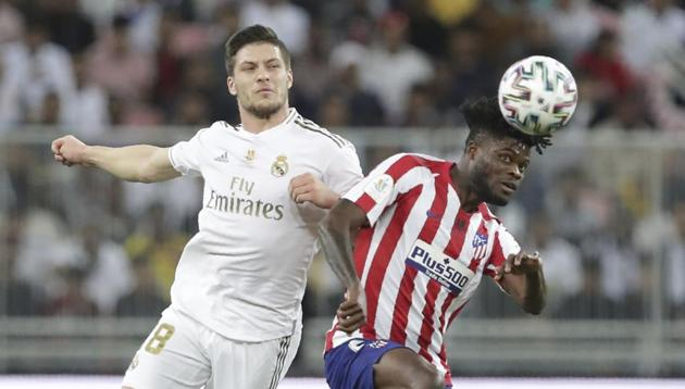 Real Madrid's Luka Jovic, left, fights for the ball with Atletico Madrid's Thomas Partey(AP)
