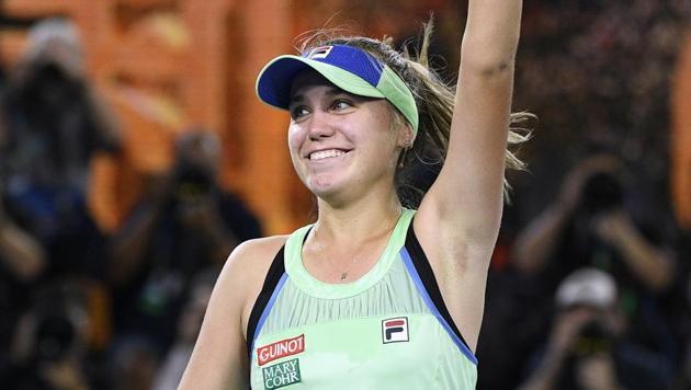Sofia Kenin celebrates after defeating Spain's Garbine Muguruza in the women's singles final at the Australian Open.(AP)
