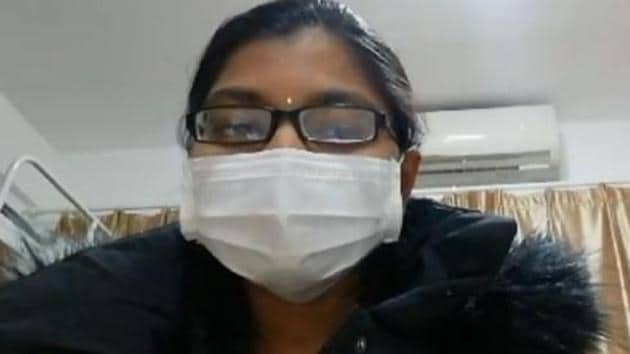 The woman, who can be seen with her face covered in a mask, says in the video that she and her colleague do not have any symptom of the fast-moving coronavirus.(Video/Screengrab)