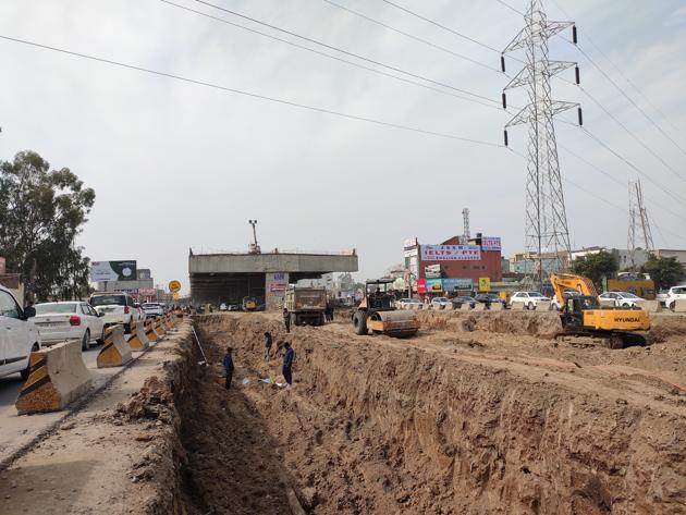 Work on the Kharar flyover being carried out on Tuesday. The ₹369-crore project has missed three deadlines.(HT PHOTO)