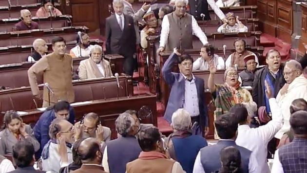 Opposition MPs raise slogans during the Budget Session of Parliament, at Rajya Sabha, in New Delhi on February 3(ANI Photo)