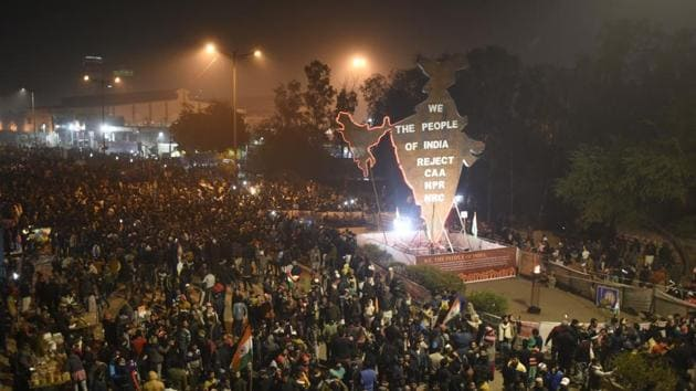 People gather to protest against the Citizenship Amendment Act (CAA) in New Delhi.(Burhaan Kinu/HT PHOTO)