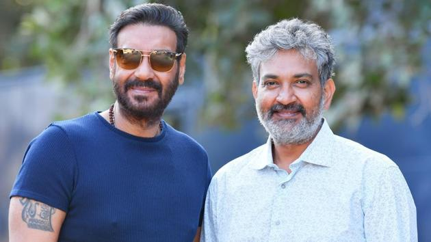 Ajay Devgn and SS Rajamouli pose on the sets of RRR.