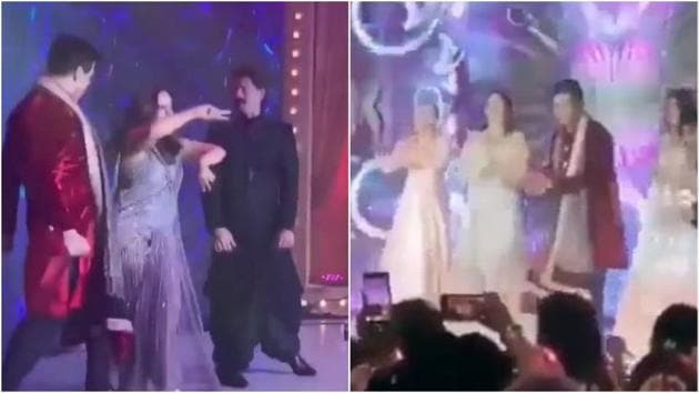 Karan Johar, Gauri Khan and Shah Rukh Khan performing at the reception.