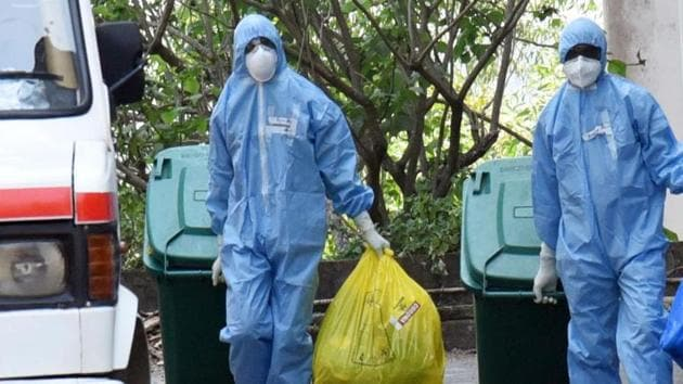 Medical staff fully covered with protective suits disposing of waste as they exit from a coronavirus isolated ward at Kochi Medical collage in Kerala.(ANI Photo)