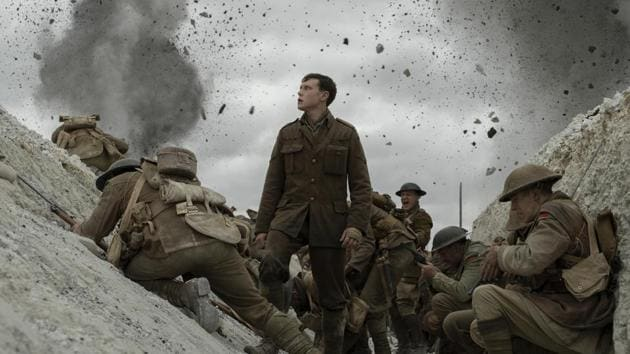 This image released by Universal Pictures shows George MacKay, center, in a scene from 1917.(AP)