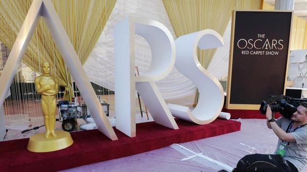 Cameramen film an Oscar statue on the red carpet as Oscars preparations continue for the 92nd Academy Awards in Hollywood, Los Angeles, California.(REUTERS)