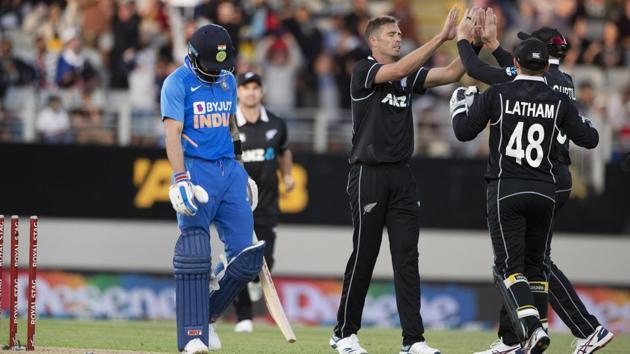 New Zealand bowler Tim Southee celebrates the wicket of India's Virat Kohli.(AP)