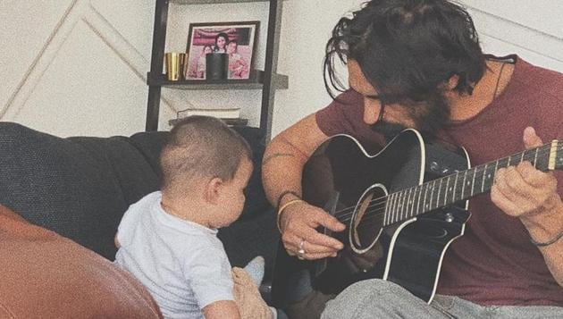 Arjun Rampal plays the guitar for his son Arik.