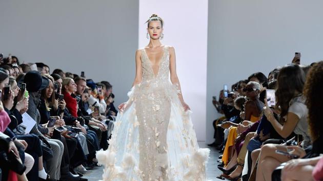 A model walks the runway for Badgley Mischka during New York Fashion Week.(AFP)