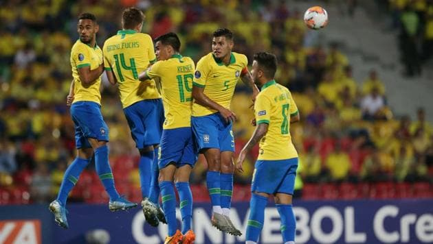 Brazil players in action during a defensive wall.(REUTERS)