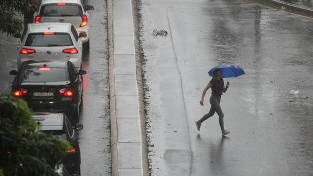 A pedestrian braves strong wind and rain in Sydney, New South Wales, Australia.(Reuters image)