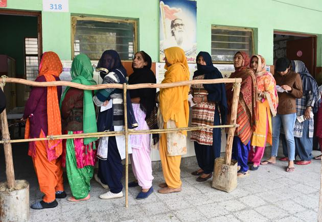 New Delhi, India - February 8, 2020: Women stand in a queue to cast their votes during Vidhan Sabha elections, at a school in Chhaniwalaa village, Najafgarh, in New Delhi, India, on Saturday, February 8, 2020. (Photo by Vipin Kumar / Hindustan Times)(Vipin Kumar/HT PHOTO)
