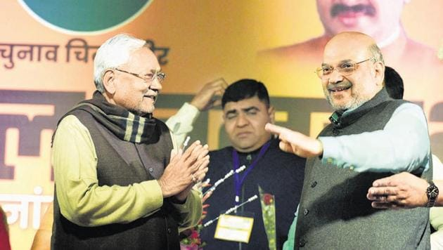 Bihar Chief Minister and Janata Dal (United) president Nitish Kumar with Union Home Minister Amit Shah at an election rally in New Delhi.(HT PHOTO)