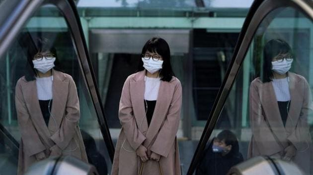 A woman wearing a mask is seen in Shanghai as China is hit by an outbreak of the novel coronavirus.(Reuters Photo)