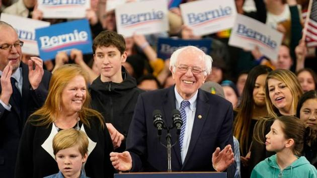 Democratic U.S. presidential candidate Senator Bernie Sanders is accompanied by his wife Jane O'Meara Sanders and other relatives as he speaks at his New Hampshire primary night rally in Manchester, N.H., U.S., February 11, 2020.(REUTERS)