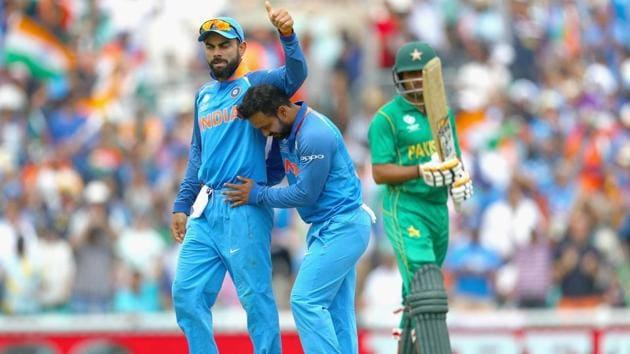 Kedar Jadhav of India celebrates the wicket of Babar Azam of Pakistan with Virat Kohli.(Getty Images)