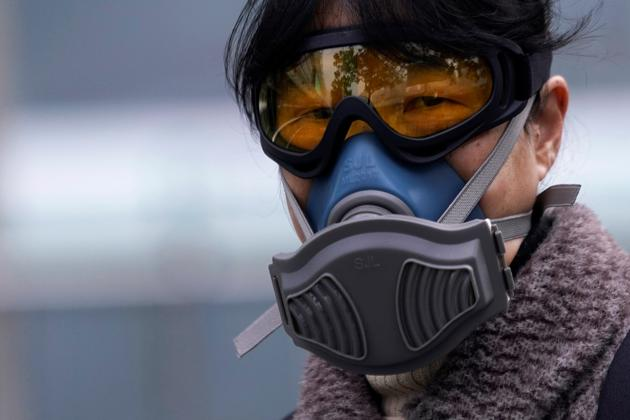 A woman wearing a mask is seen at a subway station in Shanghai, China, as the country is hit by an outbreak of the novel coronavirus, February 13, 2020.(REUTERS)
