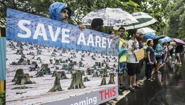 The protestors said they were not against the project but were opposing the cutting of more than 2,000 trees in the Metro car shed plot.(HT File)