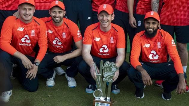 England's captain Eoin Morgan, second from right, with teammates pose for photographers after winning the T20 cricket series against South Africa at Centurion Park.(AP)