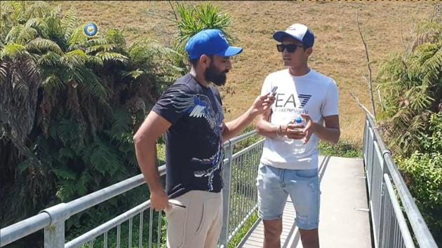 Navdeep Saini speaks to Mohammed Shami.(BCCI/Twitter)