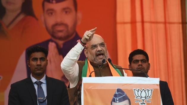 Union Home Minister Amit Shah addresses a gathering at Sadar Bazar, Delhi Cantt, in New Delhi.(Biplov Bhuyan/HT PHOTO)