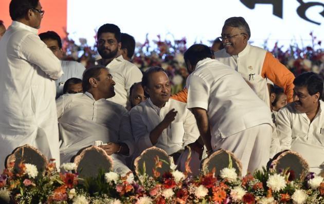 Nawab Malik, Praful Patel, Ajit Pawar interacts with Ramdas Kadam along with Chandrakant Khaire and Ashok Chavan during the swearing ceremony at Shivaji Park Dadar in Mumbai.(Anshuman Poyrekar/HT file photo)