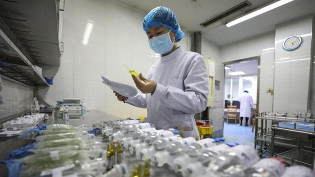 A nurse prepares medicines for patients at Jinyintan Hospital in China's Wuhan. India has sent a consignment of medical supplies to China to tackle coronavirus outbreak.(AP Photo)