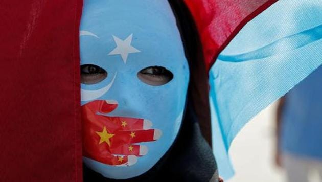 An ethnic Uighur demonstrator wears a mask as she attends a protest against China in front of the Chinese Consulate in Istanbul, Turkey(REUTERS FILE)