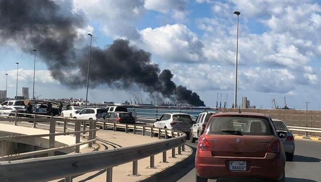 A smoke rises from a port of Tripoli after being attacked in , Libya.(REUTERS)