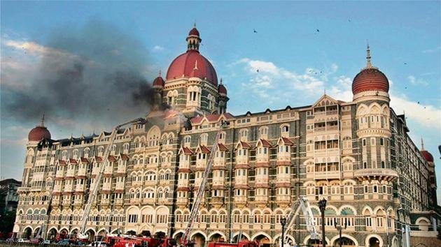 Firemen douse the fire at the top floor of the Hotel Taj after a terrorist attack in Mumbai in November, 2008.