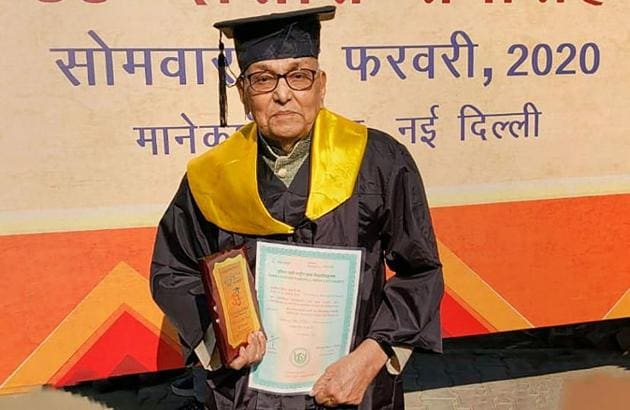 93-year-old C I Sivasubramanian poses for photographs with his masters degree from Indira Gandhi National Open University (IGNOU) in New Delhi, Monday, Feb. 17, 2020.(PTI)