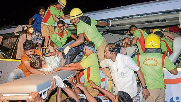 Rescue personnel and volunteers help the injured passengers after a bus accident in Tamil Nadu's Tirupur district on Thursday.(PTI)