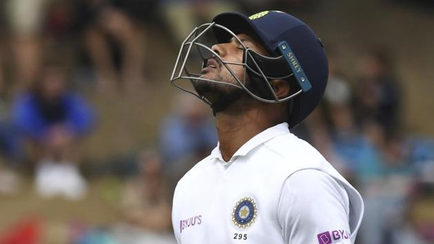India's Mayank Agarwal reacts after being dismissed by New Zealand's Trent Boult for 34 during the first cricket test between India and New Zealand at the Basin Reserve in Wellington, New Zealand.(AP)