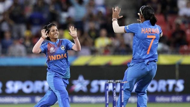 India's Poonam Yadav, left, celebrates with teammate Harmanpreet Kaur after taking the wicket of Australia's Jess Jonassen during the first game of the Women's T20 Cricket World Cup in Sydney.(AP)