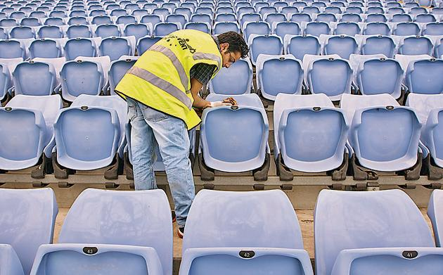Mr Cleaner: Wiping seats at a stadium in Sydney, Australia.(Cameron Spencer/Getty Images)