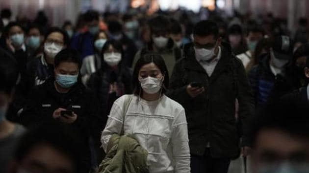 """The authors of the study argued that a """"patient zero"""" could have passed on the virus to workers or sellers at the Huanan seafood market and subsequently, the crowded market facilitated the further transmission of the virus to buyers.(AP PHOTO.)"""