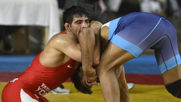 Jitender Kumar in action against Amit Dhankar during the 74kg trial final bout to qualify for the Asian Championship.(Burhaan Kinu/HT PHOTO)